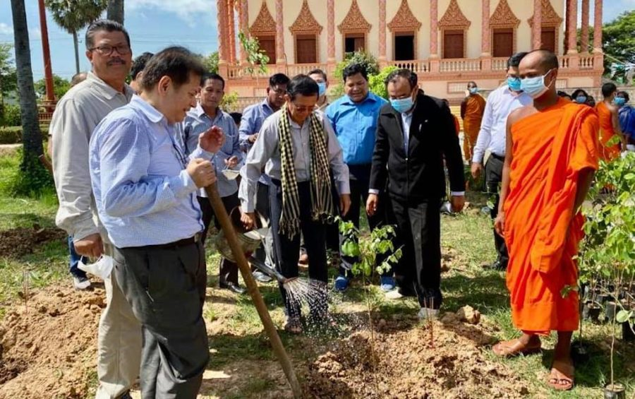 Kem Sokha waters a newly planted tree at Wat Pothivong in Prey Veng province's Svay Antor commune on August 29, 2020, in this photograph posted to his attorney Chan Chen's Facebook page.