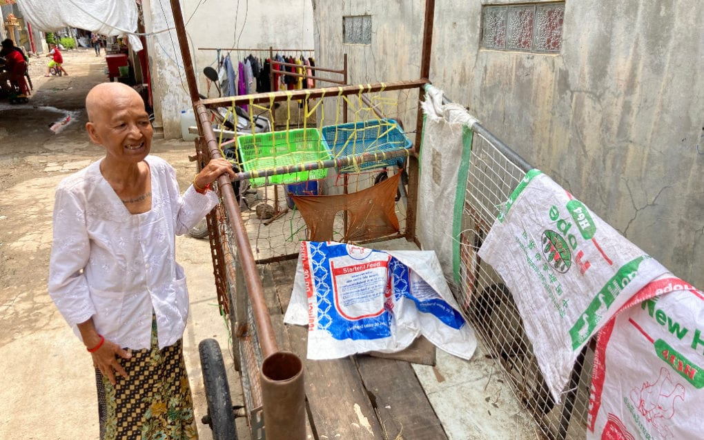Keo Pao, an edjai in Poipet, shows the cart she uses to collect recyclable waste in the border city. (Ananth Baliga/VOD)