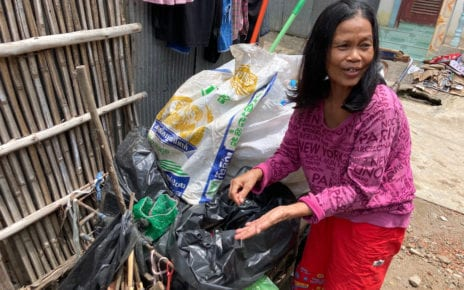 Keo Chen says she mostly collects plastic materials and bottles when she picks through waste with her sister, and unemployed porter, Keo Srun in Banteay Meanchey's Poipet city. (Ananth Baliga/VOD)