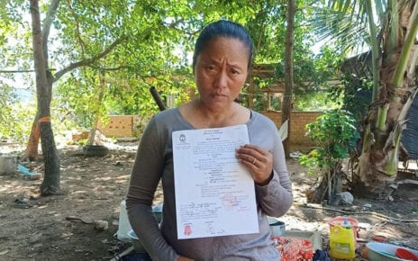 Oum Sophy, a representative of land protesters in Kampong Chhnang province's Lor Peang village, holds up a court order, in a photo posted to the Lor Peang community's Facebook page.