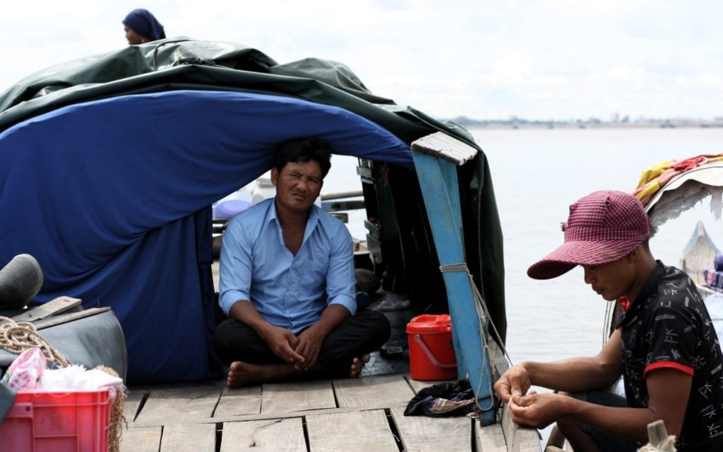 Yan Khouvry, center, prepares to depart for this day's fishing, in Phnom Penh's Chroy Changva on September 15, 2020. (Michael Dickison/VOD)