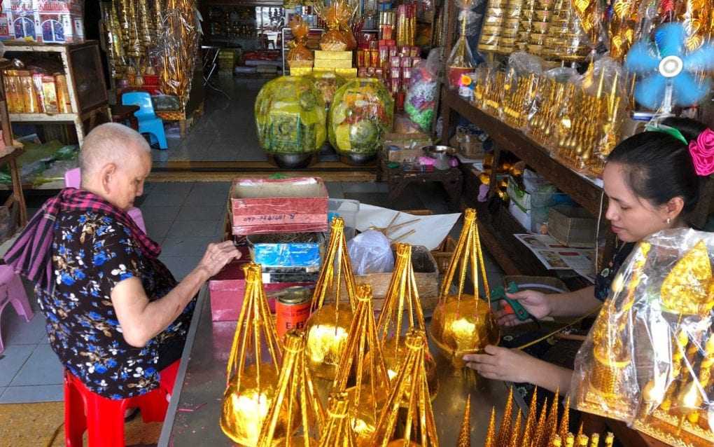 Bun Sam Art, 83, and her 34-year-old granddaughter Mom Chanthy, at their shop near O'Russei Market in Phnom Penh on September 15, 2020. (Matt Surrusco/VOD)