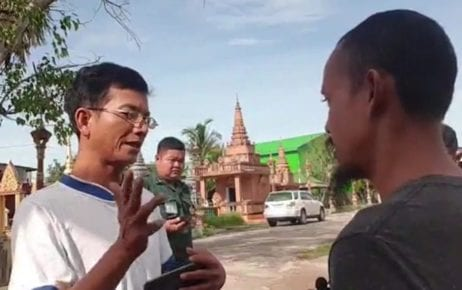 Authorities interrogate Srun Srorn (right) during a Facebook live broadcast about the Paris Peace Agreements in Takeo province's Bati district on September 23, 2020, in this screenshot from the video posted to the Paris Peace Treaty Facebook page.