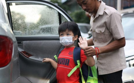A student from Bamboo International School in Phnom Penh heads home after his first day at school since Covid-19 closures in March, on October 1, 2020. (Michael Dickison/VOD)