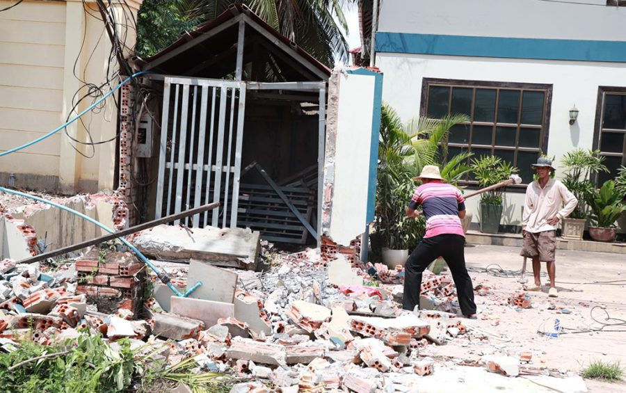 Workers demolish structures along streets in Siem Reap province as part of a road expansion project, in a photo posted to the provincial administration's Facebook page on October 3, 2020.