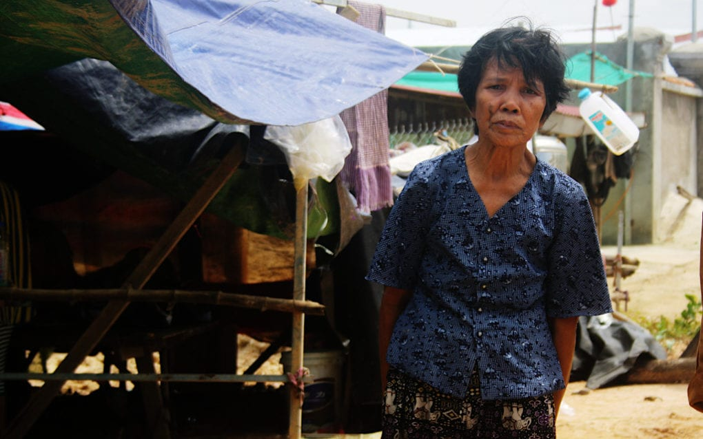 Tim Sarong, 66, is staying under a makeshift tarpaulin roof after flooding destroyed her home in Phnom Penh's Dangkao district, on October 12, 2020. (Michael Dickison/VOD)