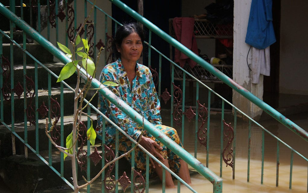 Toch Sina, 57, is staying behind at her flooded house in Spean Thma commune, in Phnom Penh's Dangkao district, on October 12, 2020. (Michael Dickison/VOD)