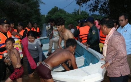 People are evacuated by boat due to flooding in Kampong Speu province's Chbar Mon City on October 14, 2020, in this photo supplied by Kampong Speu governor Vei Samnang.