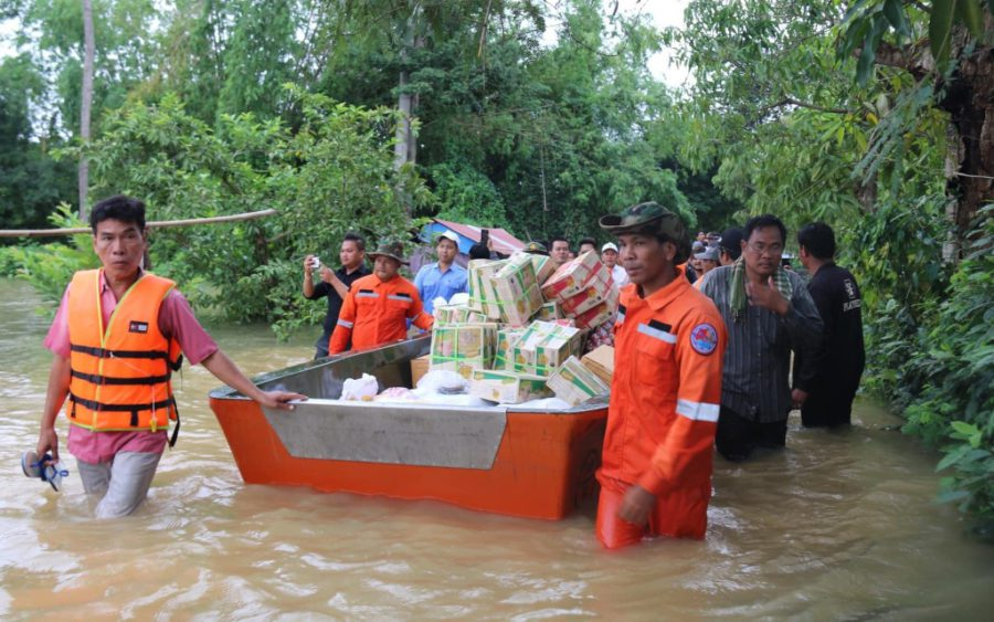 Emergency workers deliver supplies to flooded families in Mongkol Borei district in Banteay Meanchey province on October 19, 2020, in a photo posted to the provincial administration's Facebook page.