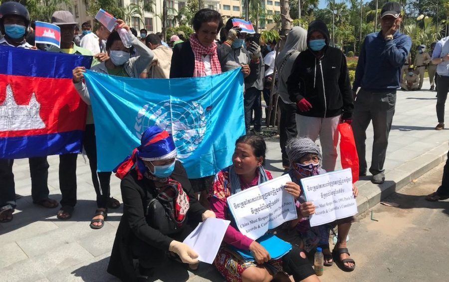 Demonstrators, including activist Sath Pha (front center), rally outside the U.S. Embassy in Phnom Penh on October 23, 2020 (Mech Dara/VOD)