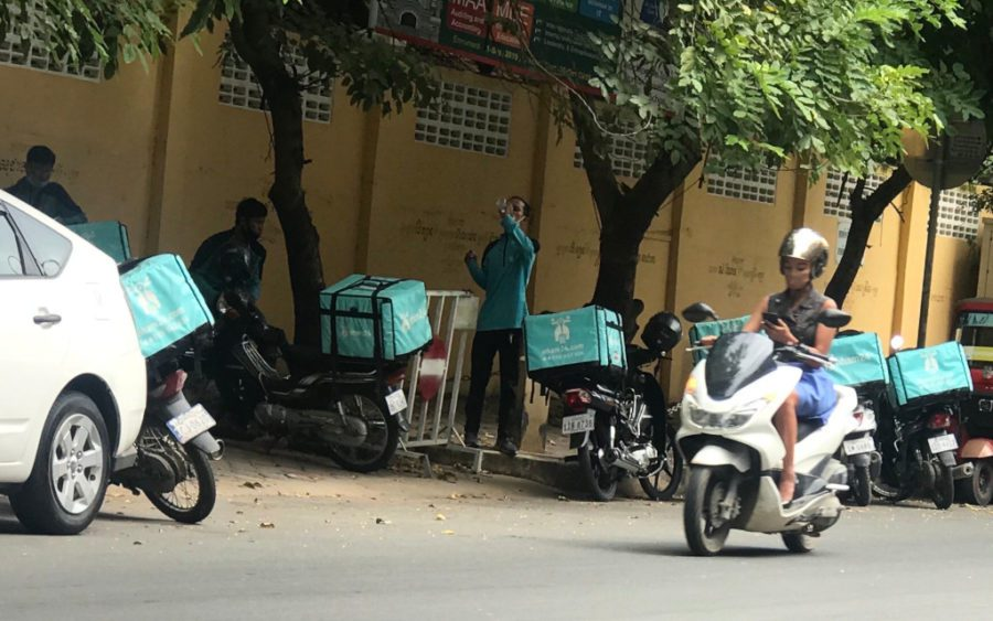 Delivery workers in Phnom Penh on October 29, 2020. (Hy Chhay/VOD)