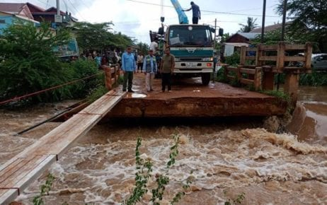 Officials from Battambang Provincial Department of Public Works and Transport inspect a damaged bridge after severe flooding from October 10 to 11, 2020, in this photograph posted to the department's Facebook page.