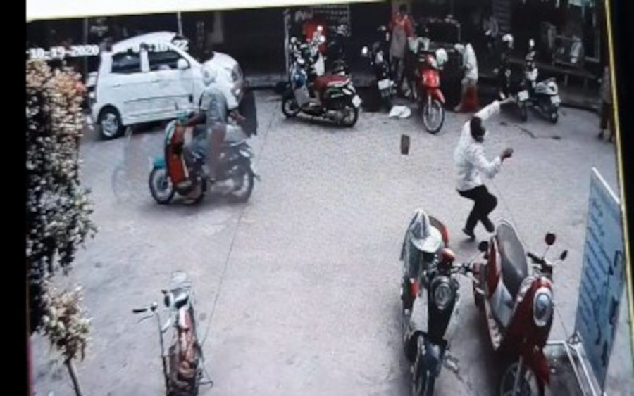 Security video footage supplied by CNRP vice president Mu Sochua shows a motorbike passenger smashing a brick onto the head of a passerby.