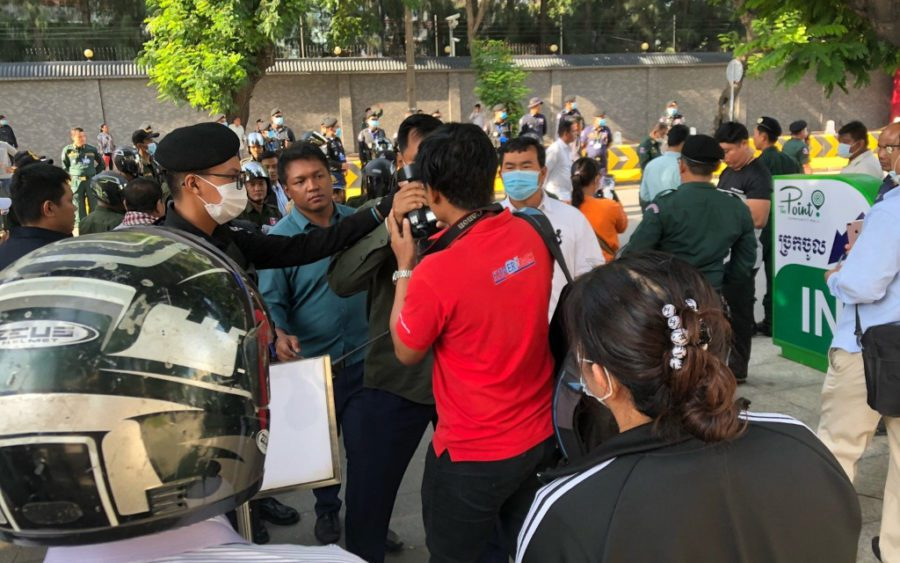 Authorities grab a camera during a small protest outside the Chinese Embassy in Phnom Penh on October 23, 2020. (Matt Surrusco/VOD)