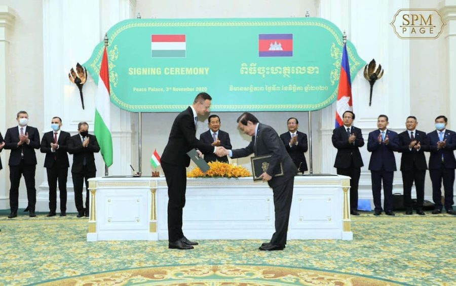 Hungarian Foreign Minister Peter Szijjarto shakes hands with Water Resources Minister Lim Kean Hor at a signing ceremony in Phnom Penh on November 3, 2020, as Prime Minister Hun Sen and other officials look on, in this photograph posted to Hun Sen's Facebook page.
