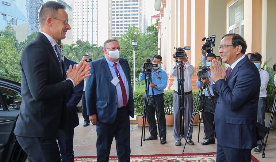 Cambodian Foreign Affairs Minister Prak Sokhonn greets his Hungarian counterpart, Peter Szijjarto, in front of several camera operators during Szijjarto's visit in Phnom Penh on November 3, 2020.