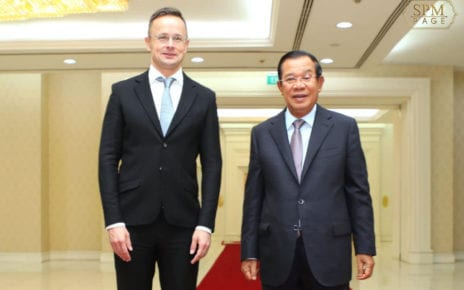 Hungarian Foreign Minister Peter Szijjarto and Prime Minister Hun Sen pose for a photo during Szijjarto's official visit to Phnom Penh on November 3, 2020, in a photo posted to Hun Sen's Facebook page.
