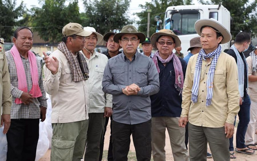 Agriculture Minister Veng Sakhon, with hands folded, visits farmers affected by flooding in Pursat province on November 4, 2020, in this photograph posted to his Facebook page.