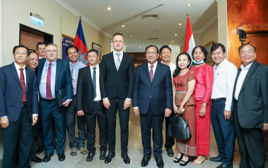 Hungarian Foreign Minister Peter Szijjarto (center) meets with Cambodian Foreign Minister Prak Sokhonn and others on November 3, 2020, in this photograph posted to the Foreign Ministry's Facebook page.