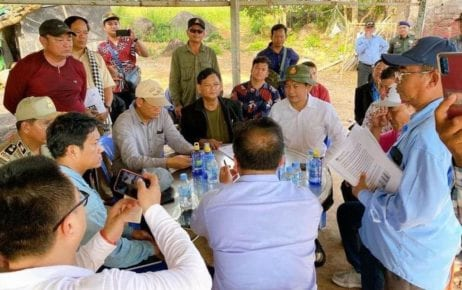 Doung Dara, an assistant to Prime Minister Hun Sen, (seated, in white shirt) meets with people in Kampot province on November 6, 2020, in this photograph posted to his Facebook page.