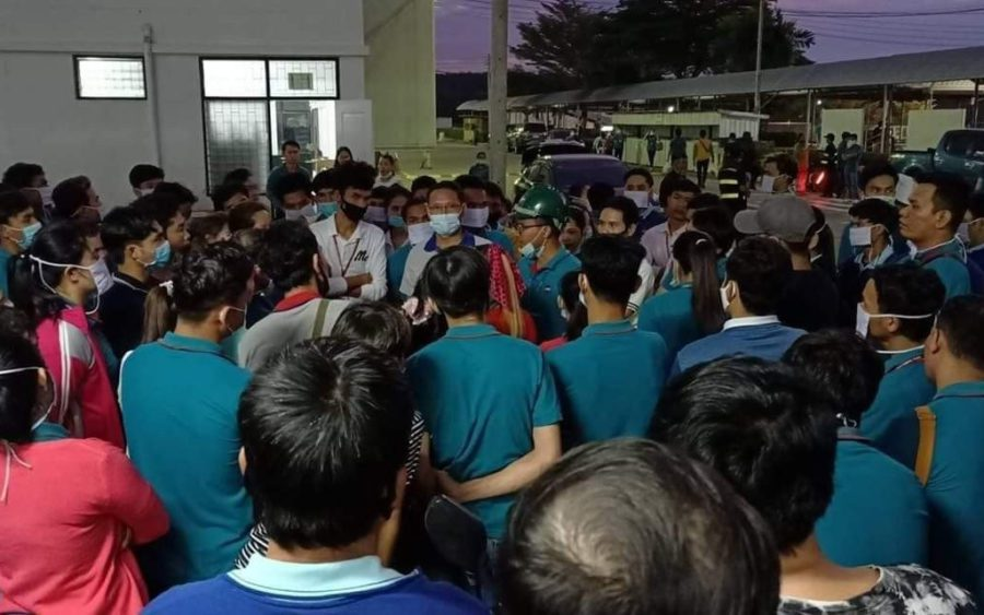 Workers gather outside the GFN chicken factory in Thailand's Chon Buri province on November 11, 2020, in a photo posted to the Facebook page of labor rights group Central.