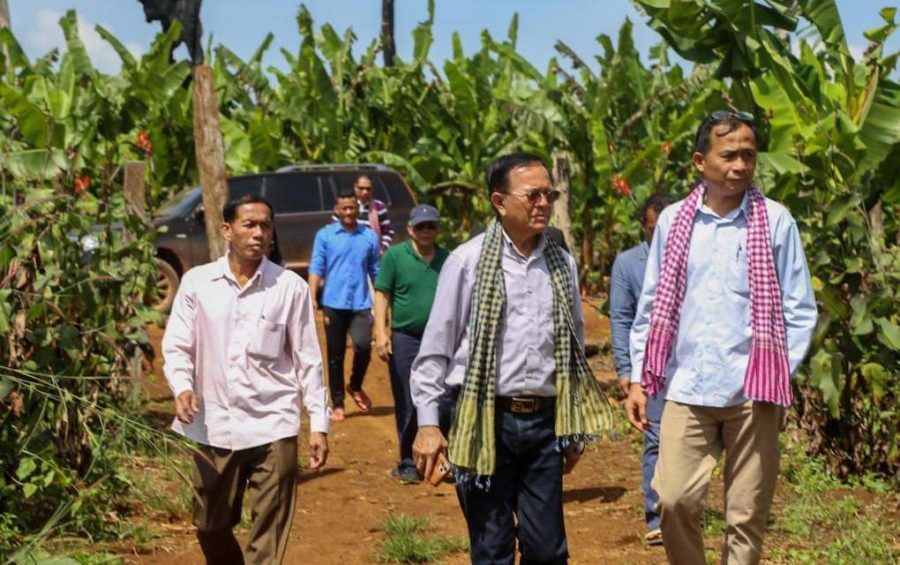 CNRP co-founder Kem Sokha, center, and GDP co-founder Yang Saing Koma, right, during a visit to a farm in Pursat province in November 2020, in this photograph posted to Saing Koma's Twitter page.
