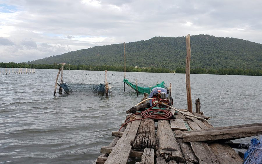 The view of a mountain and lake from the floating house of Muoy Sai, 65, a resident of Phum Ong Krao in Preah Sihanouk province's Prey Nob district on December 1, 2020. (Danielle Keeton-Olsen/VOD)