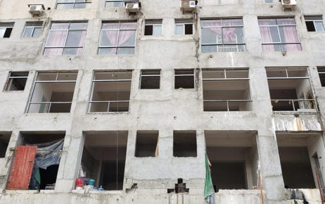 Workers' kitchens and living quarters are visible from the windows of an under-construction building in Sihanoukville on December 2, 2020. (Danielle Keeton-Olsen/VOD)