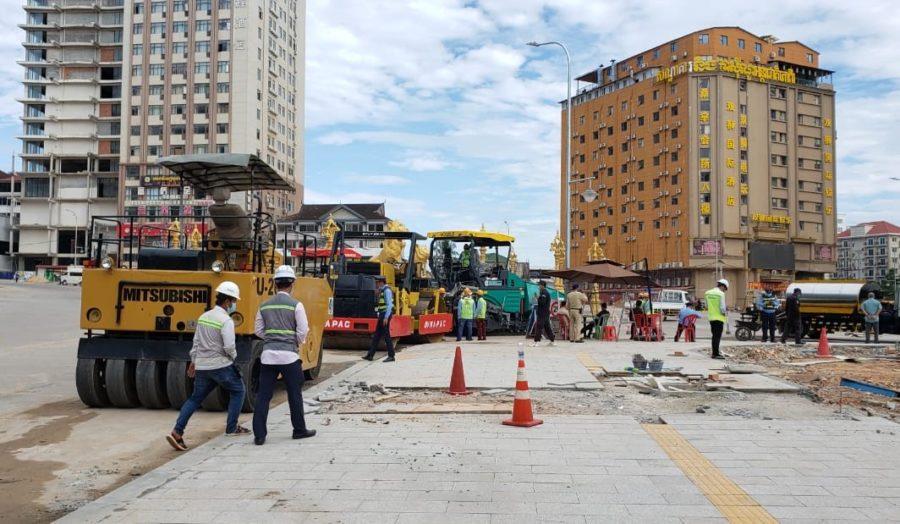 Workers repair part of a sidewalk in central Sihanoukville on December 2, 2020. (Danielle Keeton-Olsen/VOD)
