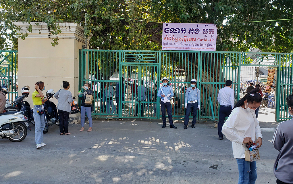 Masked police stand at the entrance of the Covid-19 testing center at Olympic Stadium in Phnom Penh on December 8, 2020. (Danielle Keeton-Olsen/VOD)
