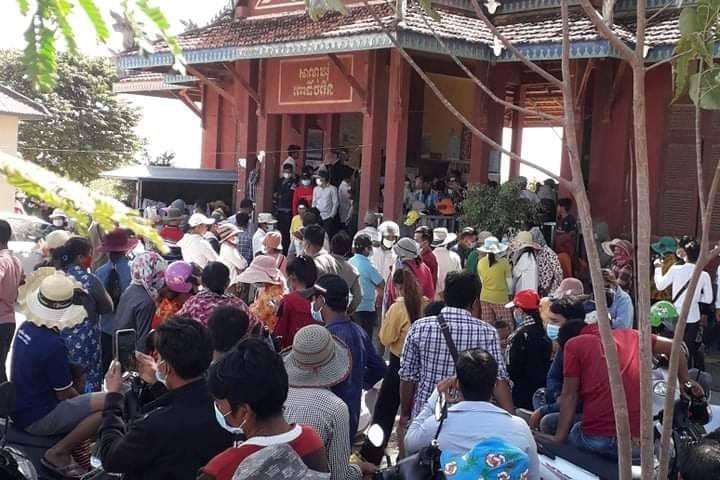 People crowd outside Kampong Speu province's Por Chamroeun commune hall seeking a solution to a multimillion-dollar scam, in a photo posted to Facebook on December 8, 2020. (Provided)