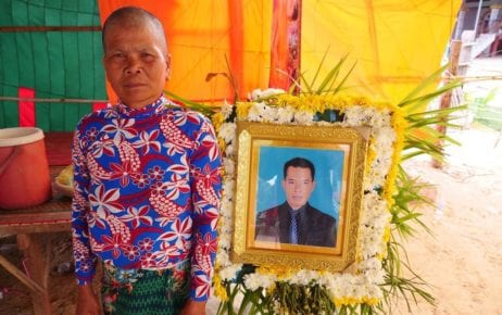 "Ngeth Samay, next to a portrait of her deceased husband Keo Puth, took out a loan of several thousand dollars from a private lender in order to invest in a Ponzi scheme. The couple put up their farmland as collateral. ""I absolutely believe that our land will be gone,"" says Samay. ""I don't know where we will find the money to pay back our debt; I am an old woman, alone."" (VOD)"
