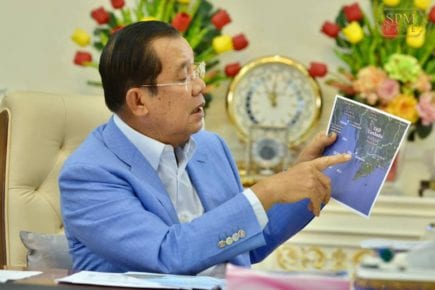Prime Minister Hun Sen points on a map to Cambodia's Block A offshore oil concession, where KrisEnergy has extracted the nation's first drops of oil, in a photo posted to his Facebook page on December 29, 2020.