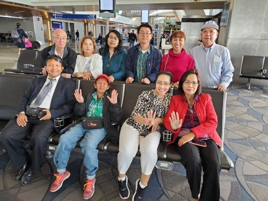 CNRP supporter Jeng Sheng Quach, top left, with other CNRP supporters at the Los Angeles International Airport before leaving for Thailand in November 2019. (Supplied)