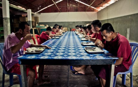 Men eat at a government-run drug rehabilitation center in Siem Reap in 2012. (Benoit Matsha-Carpentier/IFRC)