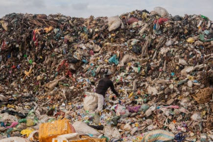 An edjai scours Battambang's landfill for salvageable goods, on November 6, 2020. (Gerald Flynn/VOD)