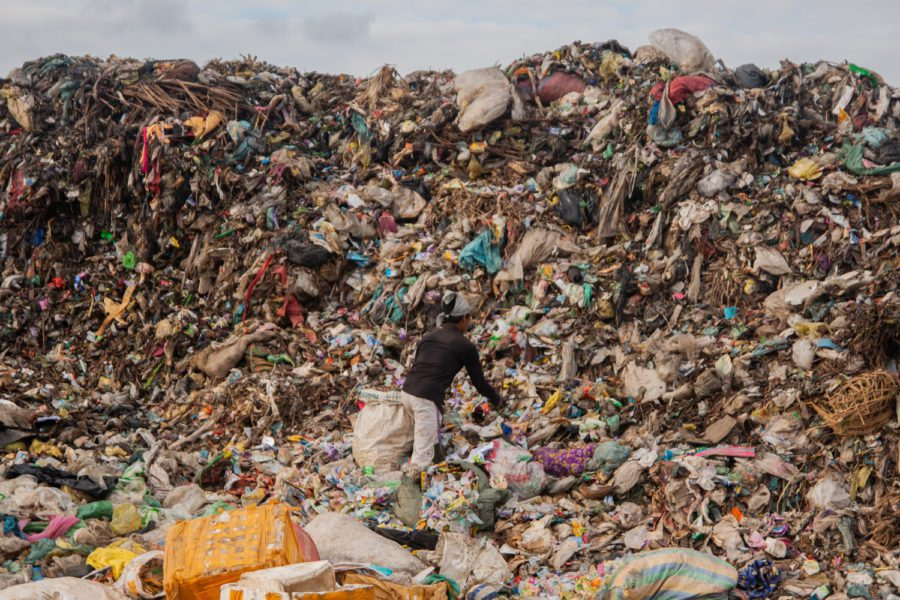 An edjai scours Battambang's landfill for salvageable goods, on November 6, 2020. (Gerald Flynn/VOD)