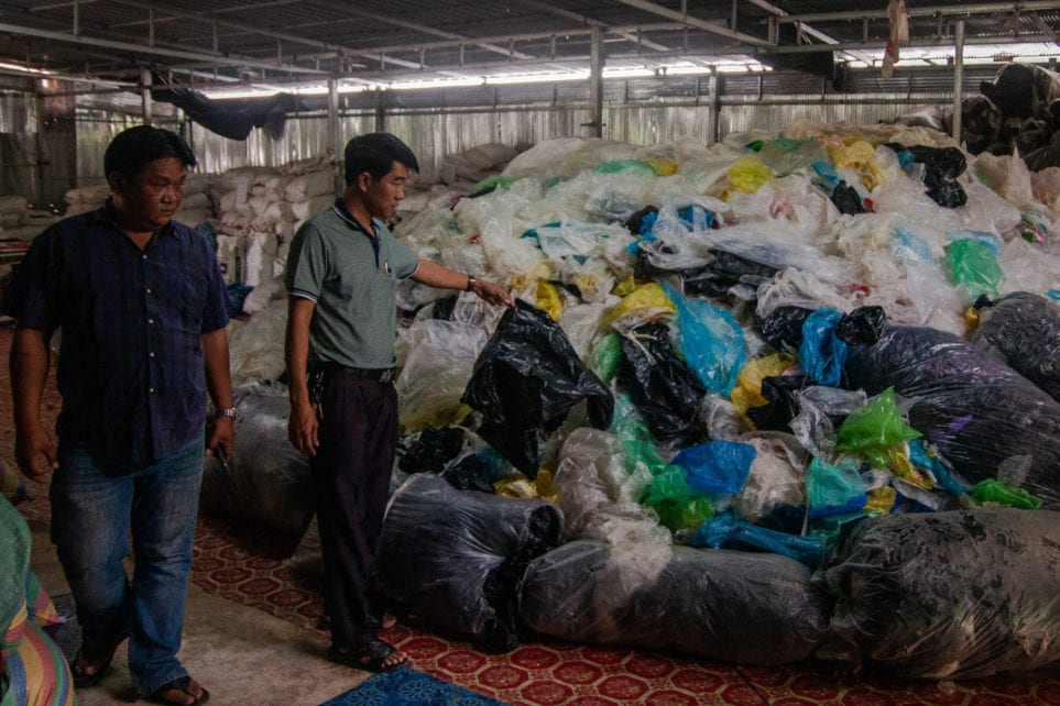 Nirat Khaengkhan and Neang Chanthara of Battambang Plastics Products explain how they collect, dry, organize and eventually recycle plastic bags from across Cambodia, on November 6, 2020. (Gerald Flynn/VOD)