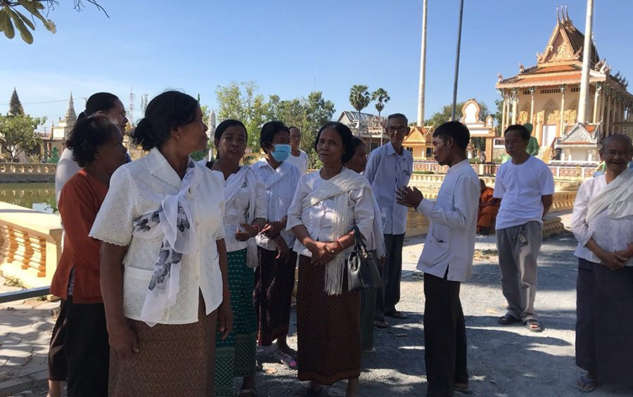 Six nuns stand in protest after a neighbor cleared land they claim is theirs at Wat Thormatrey pagoda in Phnom Penh's Dangkao district on January 6, 2021. (Mech Dara/VOD)