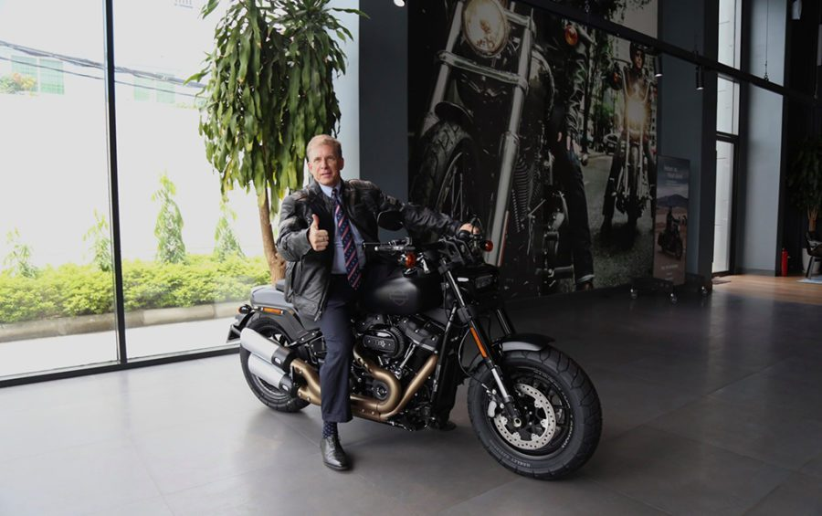 U.S. Ambassador Patrick Murphy poses on a Harley Davidson motorcycle at the Phnom Penh store, in a photo posted to the U.S. Embassy Facebook page on September 30, 2020.