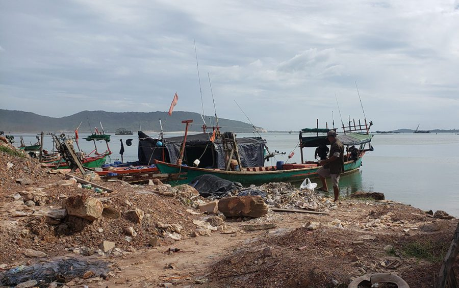 Fishermen dock their boats just north of a coastal reclamation project at Ream Bay in Preah Sihanouk province's Ream commune on December 1, 2020. (Danielle Keeton-Olsen/VOD)