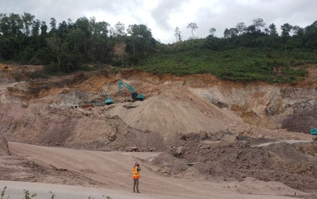 A construction worker stands in front of extensive digging of a mountain called Poy Machov in Preah Sihanouk province's Prey Nob district on December 1, 2020. (Danielle Keeton-Olsen/VOD)