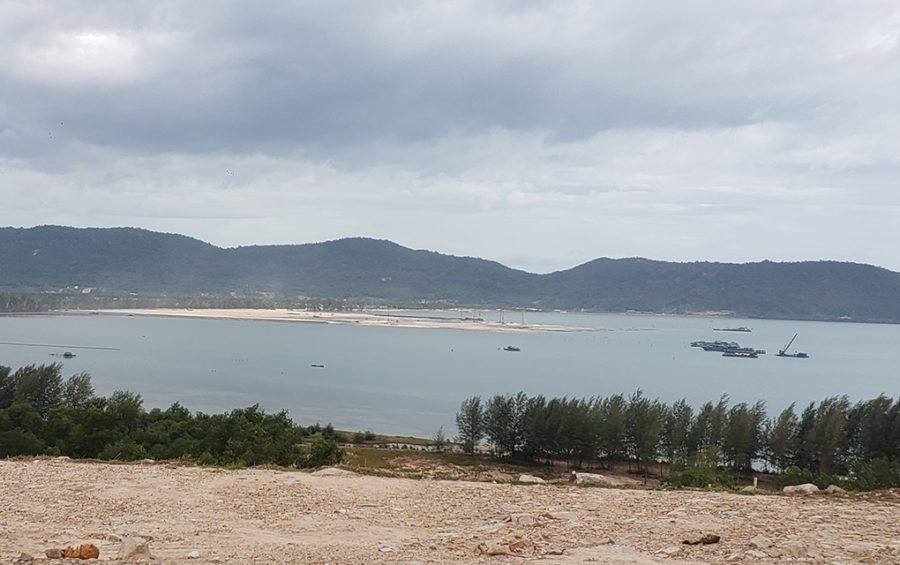 The coastal reclamation at Ream Bay and sand-hauling boats can be seen from the Poy Machov mountainside in Preah Sihanouk province's Prey Nob district on December 1, 2020. (Danielle Keeton-Olsen/VOD)