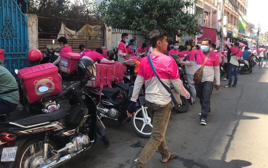 Protesting Foodpanda drivers line up near the company's Phnom Penh offices on January 4, 2020. (Mech Dara/VOD)