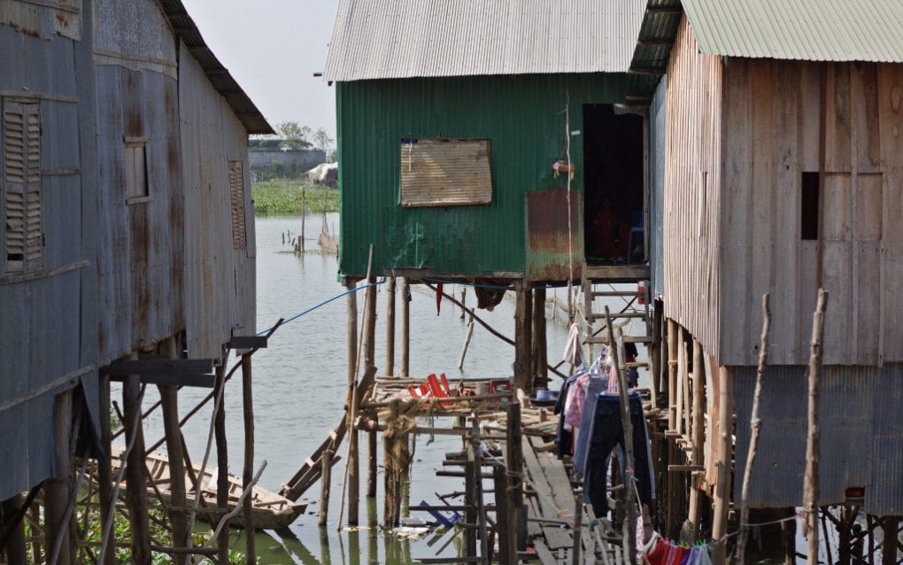 A house, in green, on Phnom Penh's Boeng Tamok lake where residents said 18 people live in a space about 4 meters by 4 meters, on January 24, 2021. (Michael Dickison/VOD)
