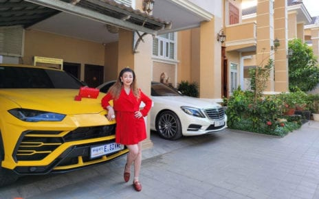 Ean Sivmey poses with a Lamborghini Urus parked at her Phnom Penh house, in a photo she posted to her business's Facebook page on November 26, 2020.
