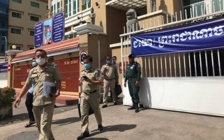 Sim Vuthy (front left), deputy director of the Interior Ministry's anti-terrorism department, and other officials leave the Phnom Penh Muncipal Court on January 29, 2021. (Ouch Sony/VOD)