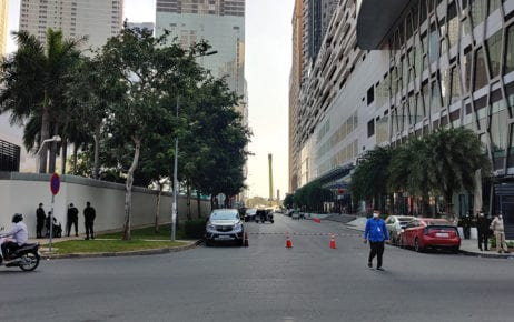 The road is barricaded in front of the Bridge high-rise building in Phnom Penh's Chamkarmorn district after a cluster of Covid-19 cases was announced on February 20, 2021. (Pete Ford)