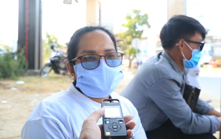 Protester Mey Sophorn speaks with a reporter near the Phnom Penh Municipal Court on February 4, 2021. (Chorn Chanren/VOD)