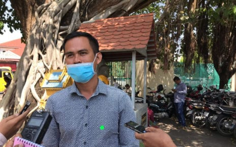 Former CNRP youth leader Hy Sokchea speaks to reporters after a trial hearing at the Phnom Penh Municipal Court on February 18, 2021. (Ouch Sony/VOD)